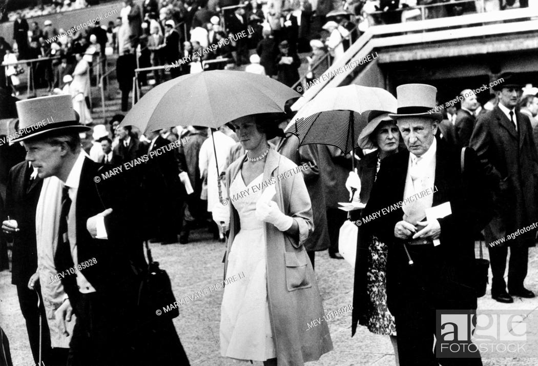 Stock Photo - At the Ascot race meeting  men in morning suits and top hats  and ladies in smart dresses and carrying umbrellas. c93b8589d7d