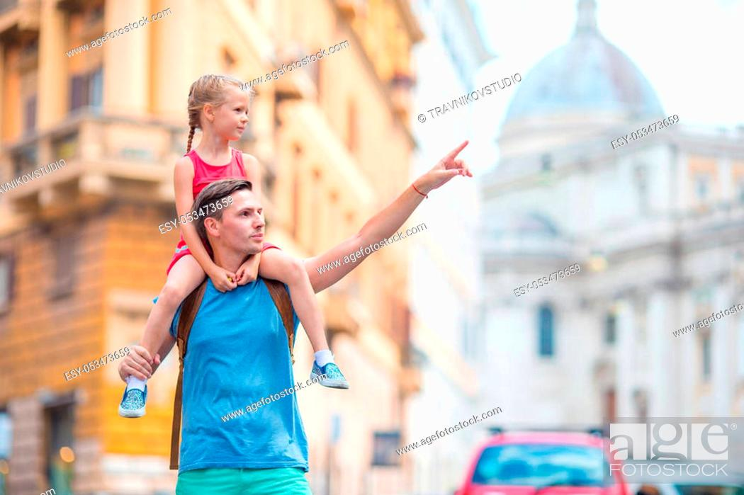 Stock Photo: Happy dad and little adorable girl traveling in Rome, Italy.