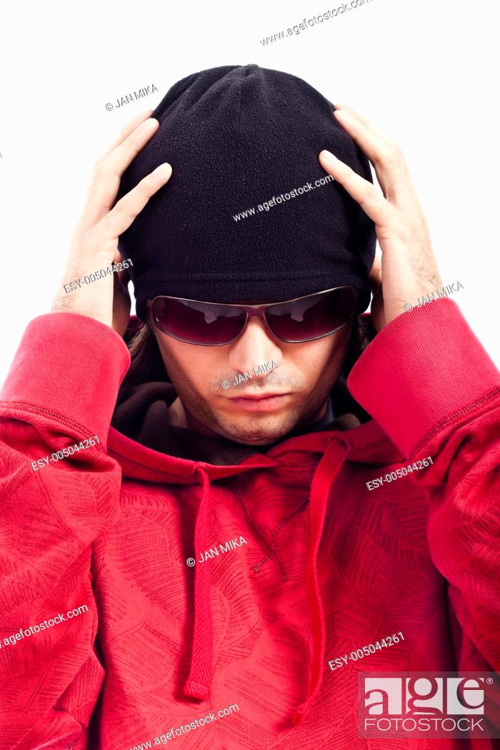 Stock Photo: Detail of Hip Hop dancer in red hoody, black hut and sunglasses.