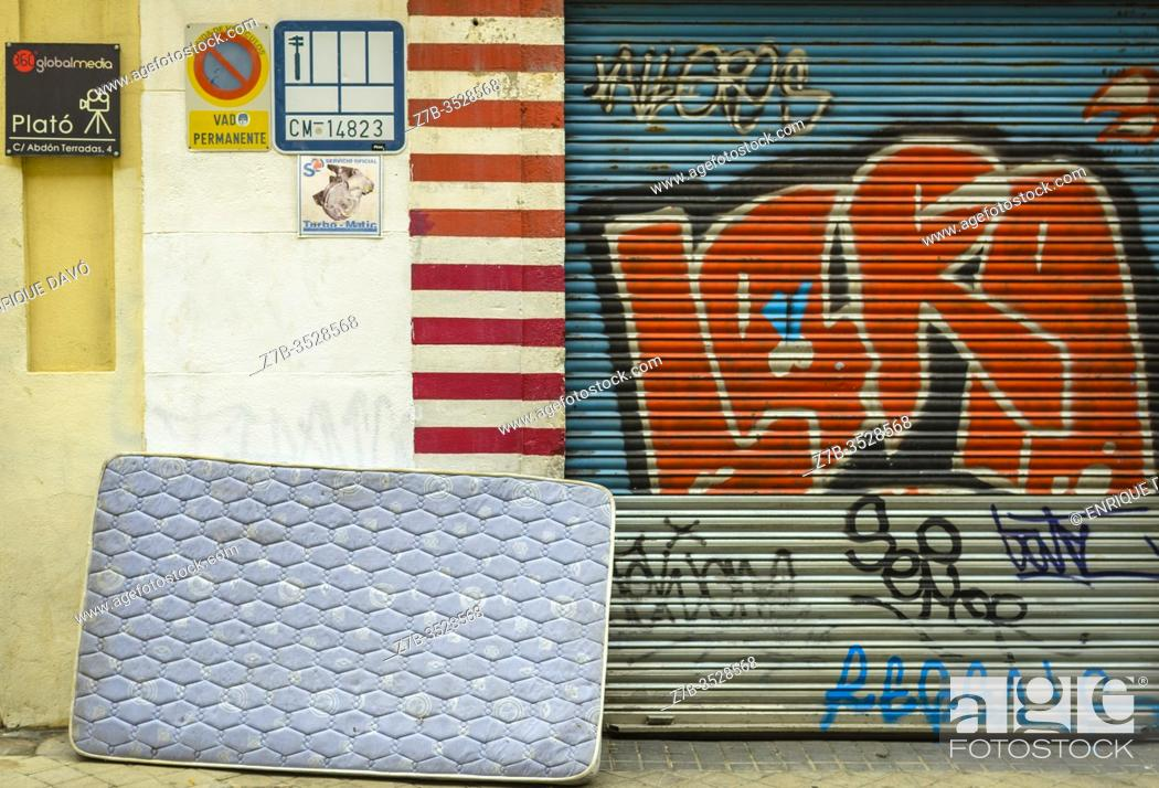 Stock Photo: View of a mattress in a street of Chamberi quarter. Madrid city, Spain. May, 2020.