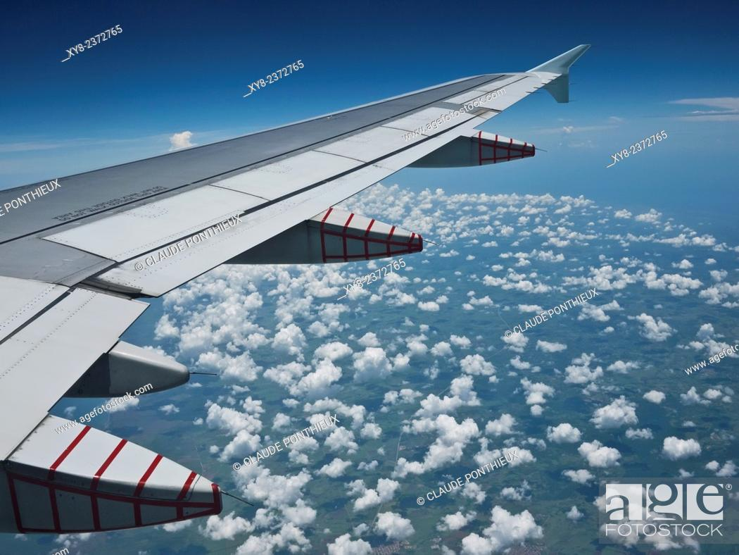 Stock Photo: Airplane wing above Cuba.
