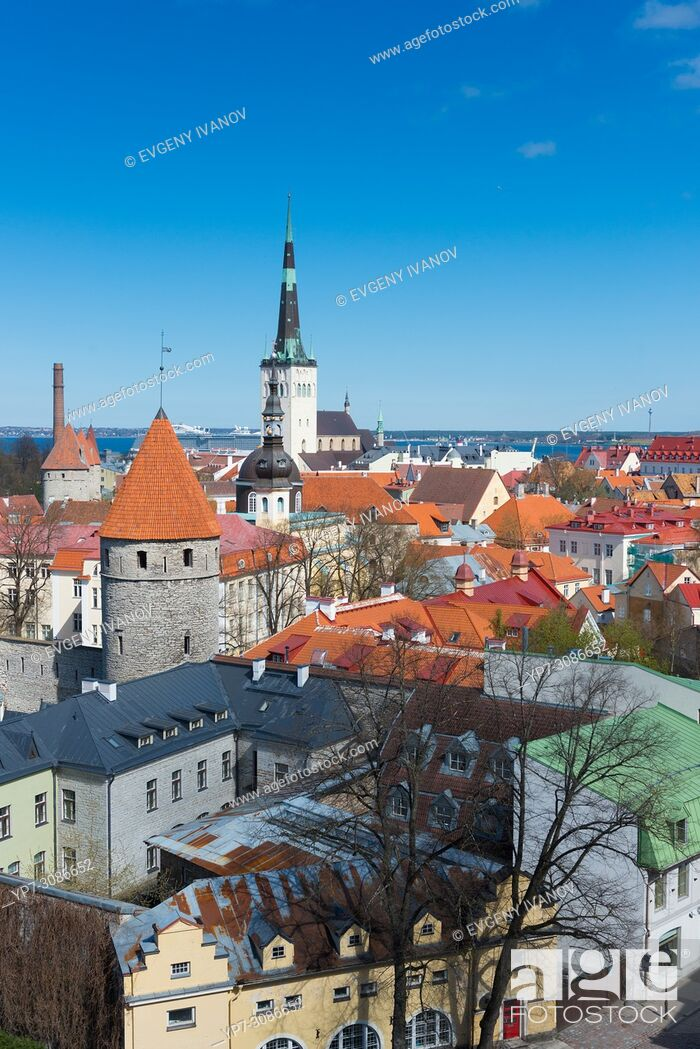 Stock Photo: Iconic view of Tallinn old town with city wall towers, Oleviste church and red roofs.