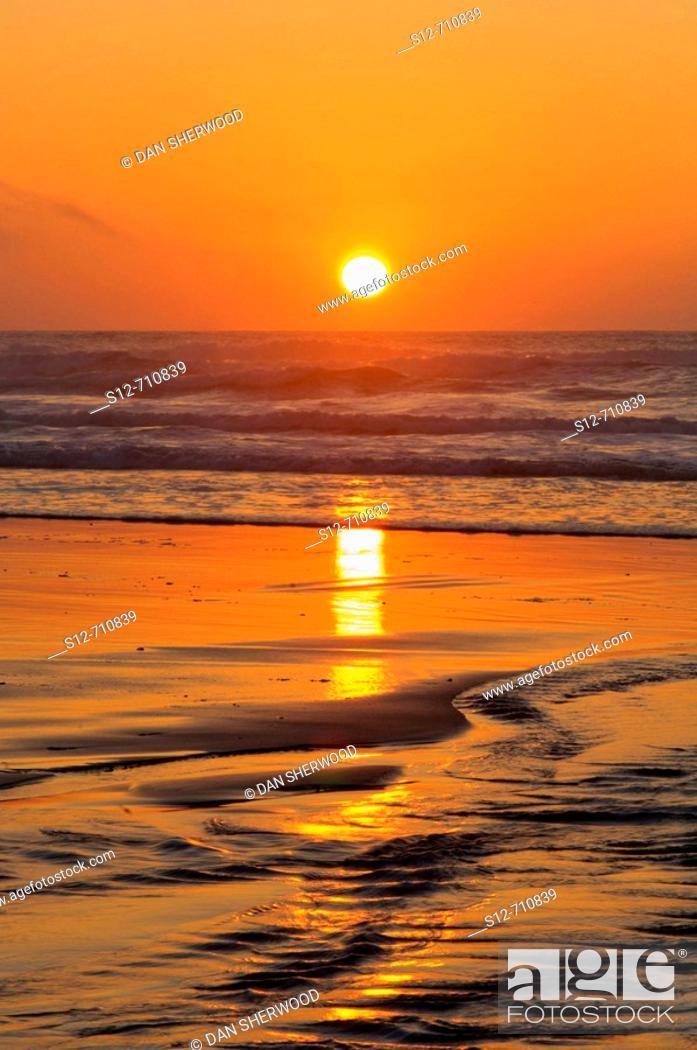 Stock Photo: Setting Sun over the Pacific Ocean - Pacific City, Oregon.