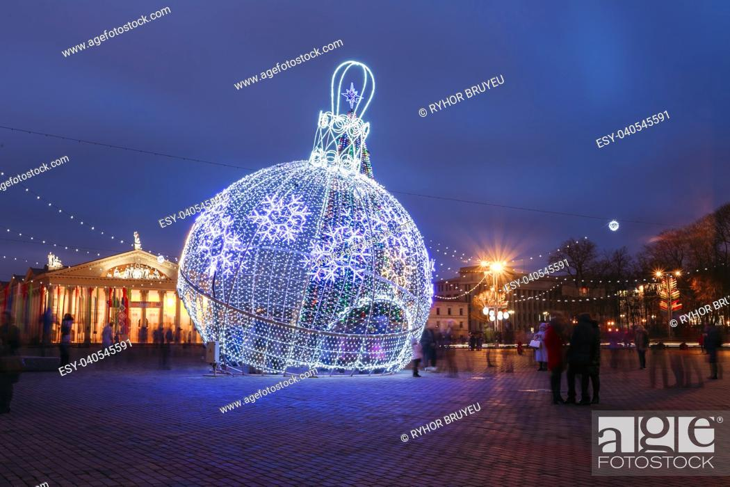 Stock Photo: City Christmas illuminations like a large ball Christmas decorations in town Oktyabrskaya Square in central Minsk, Belarus.
