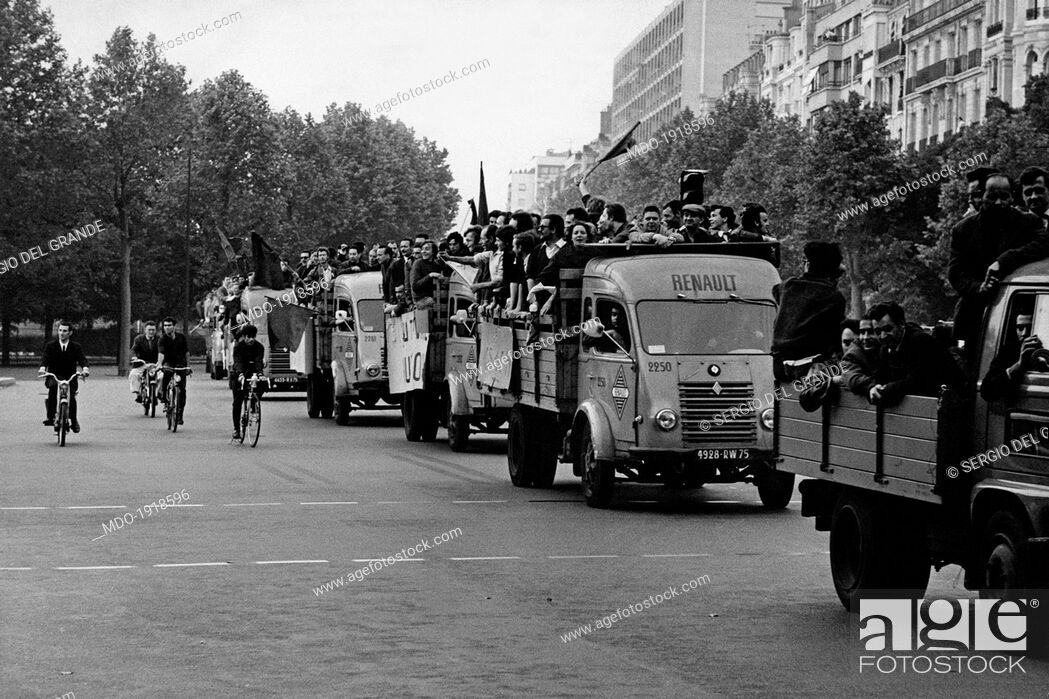 Stock Photo: Many workers at the French car company Renault demonstrating on some trucks along the streets of the city. Paris, May 1968.