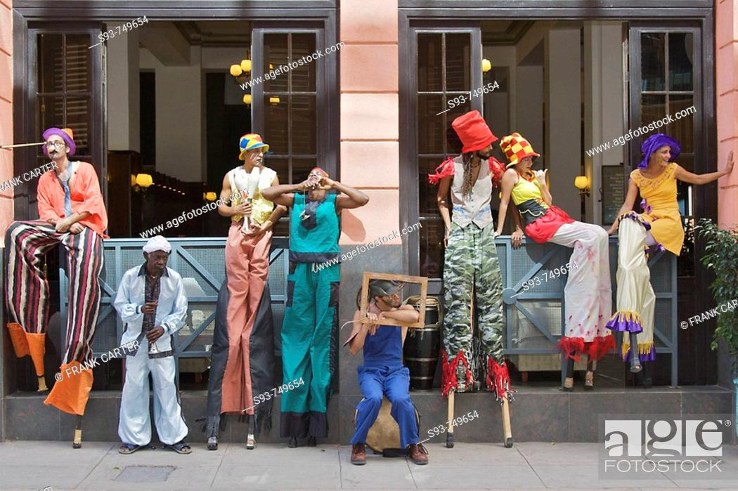 Stock Photo: A group of street performers on stilts taking a break.