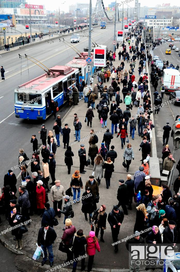 Stock Photo: Moscow, russia, march 29, 2010, crowds of passengers await surface transport vehicles on krymsky bridge next to park kultury station after two blasts rocked.