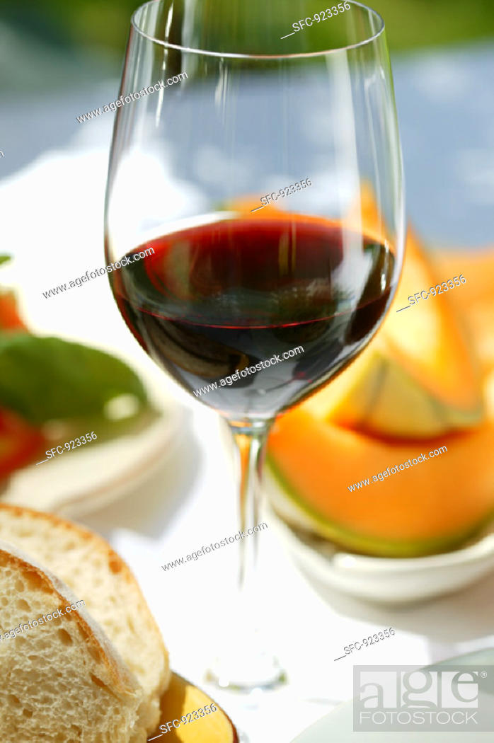 Stock Photo: Glass of red wine on Mediterranean table.