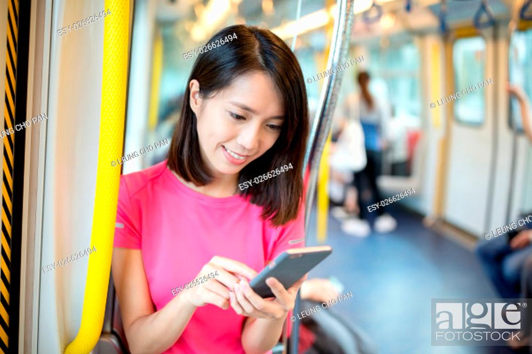 Stock Photo: Woman using mobile phone inside train.