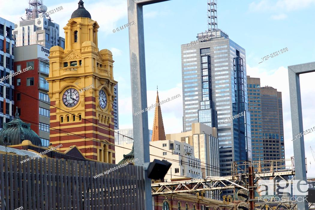 Stock Photo: long view of Melbourne city buildings over Flinders Street Station.