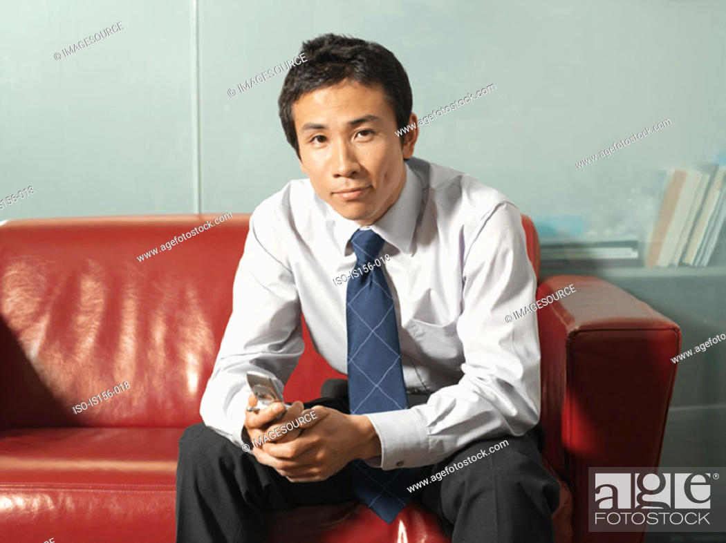 Stock Photo: Office worker with mobile phone.