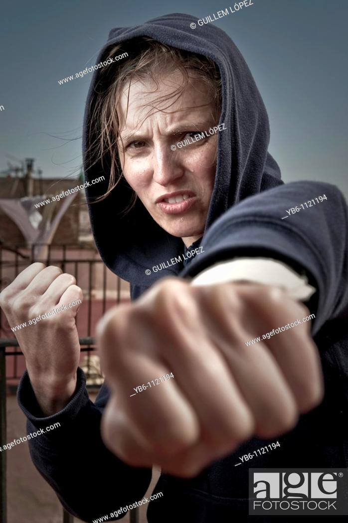 Stock Photo: Young woman in fighting pose.