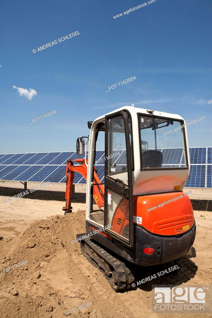 Stock Photo: Digger on solar panel construction site.