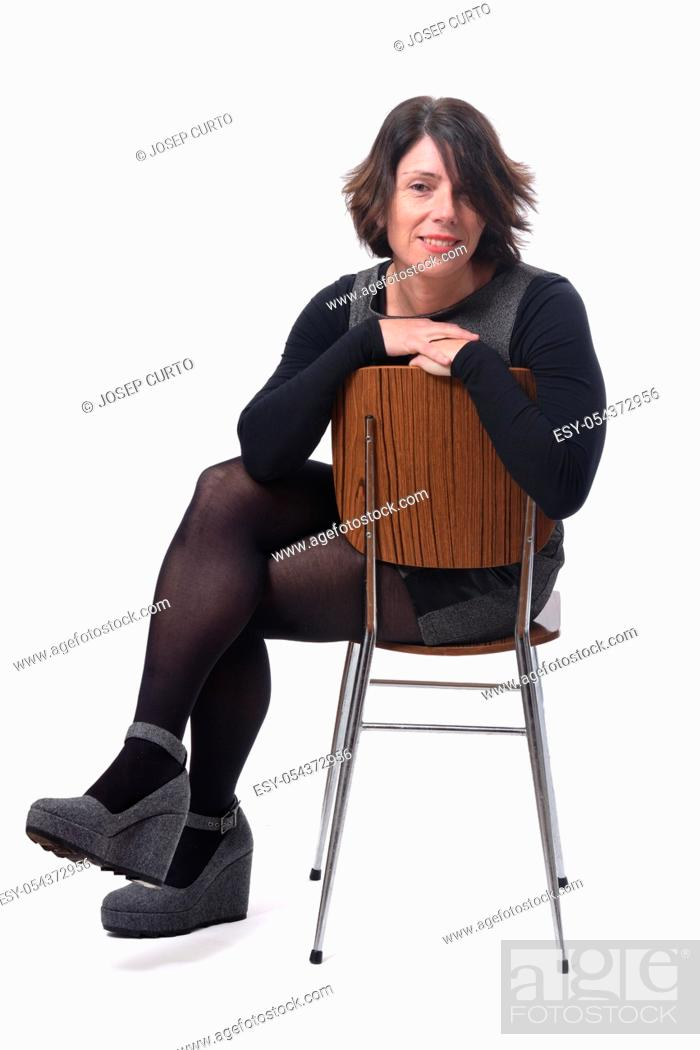 Photo de stock: view of woman in dress sitting on a white background, .