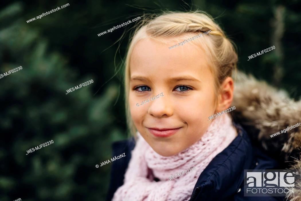 Stock Photo: Portrait of a blond little girl, smiling.