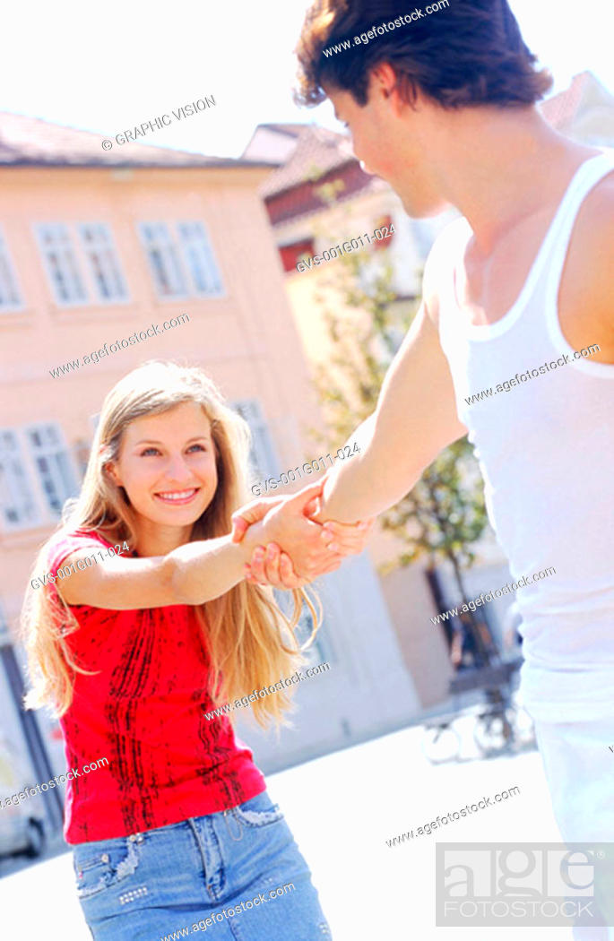 Stock Photo: Young couple holding hands.