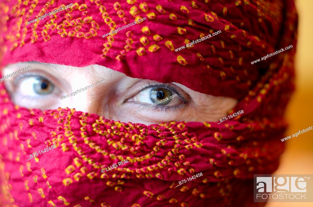 Stock Photo: Burka woman, eyes and scarf, women covered.