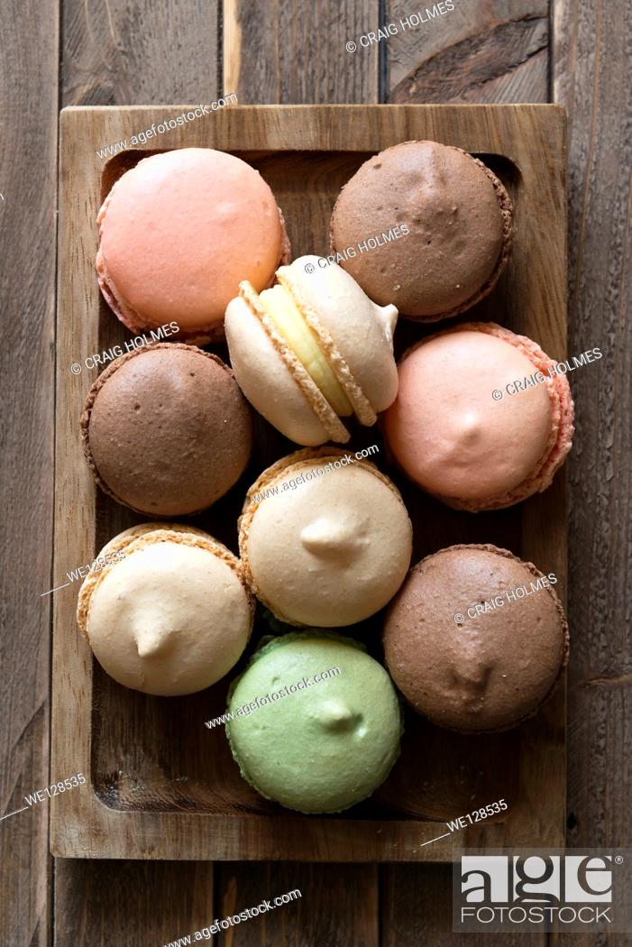 Stock Photo: Macarons, a sweet meringue-based confection made with eggs, icing sugar, granulated sugar, almond powder or ground almond, and food colouring.
