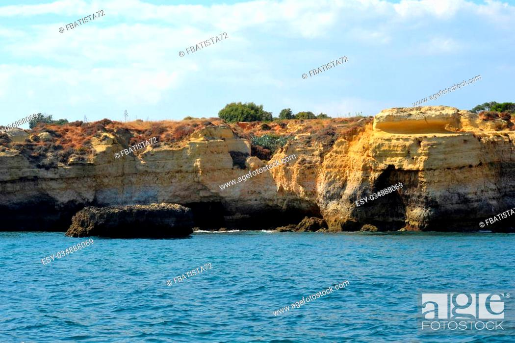 Stock Photo: Caves cliffs yellow Albufeira in the Algarve.