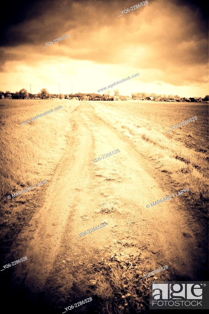 Stock Photo: Dramatic rural road in the countryside.