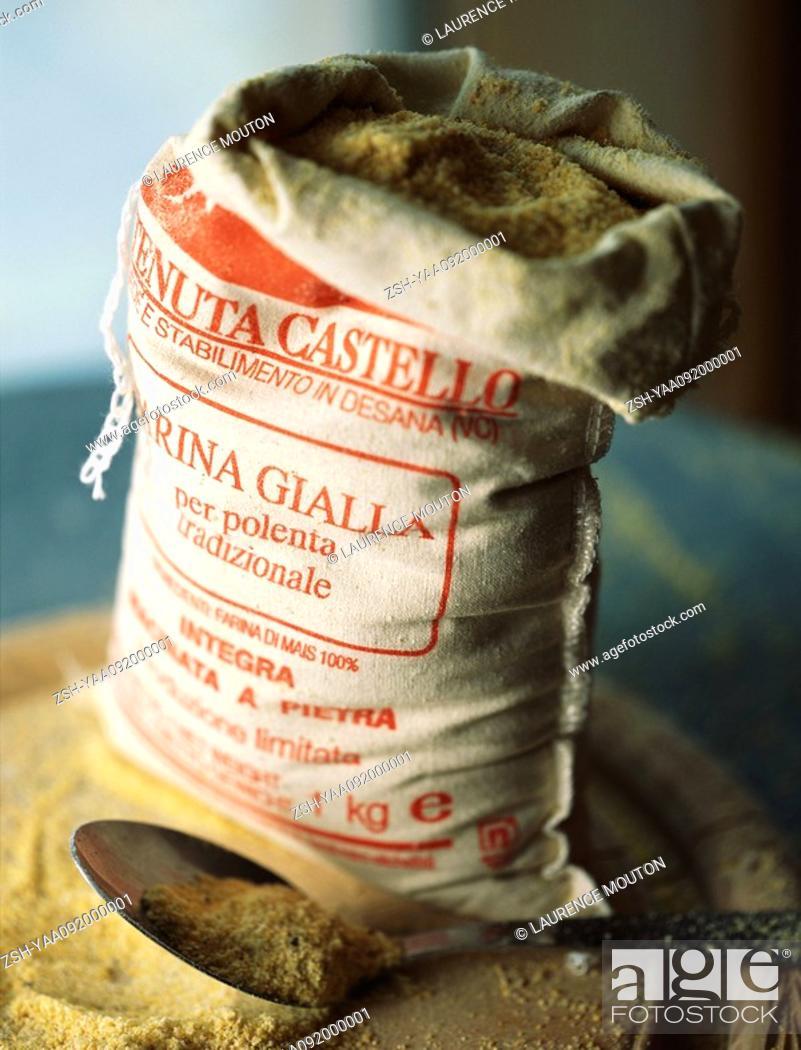 Stock Photo: Open sack of polenta corn meal with metal scoop.