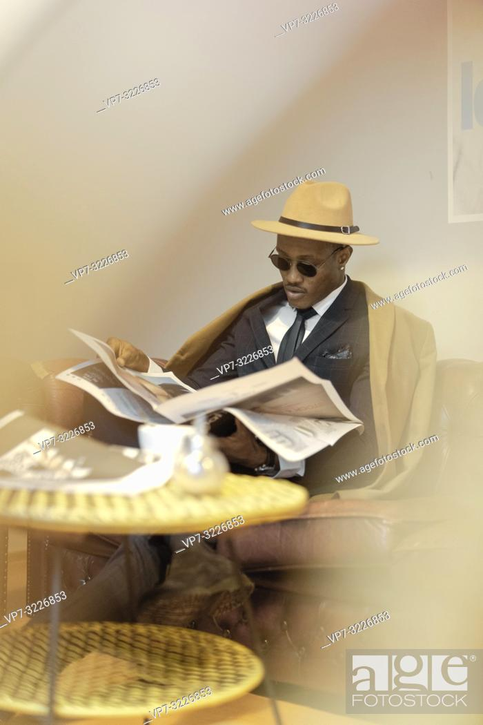 Stock Photo: man, sofa, newspaper, café, resting, break, relaxing.