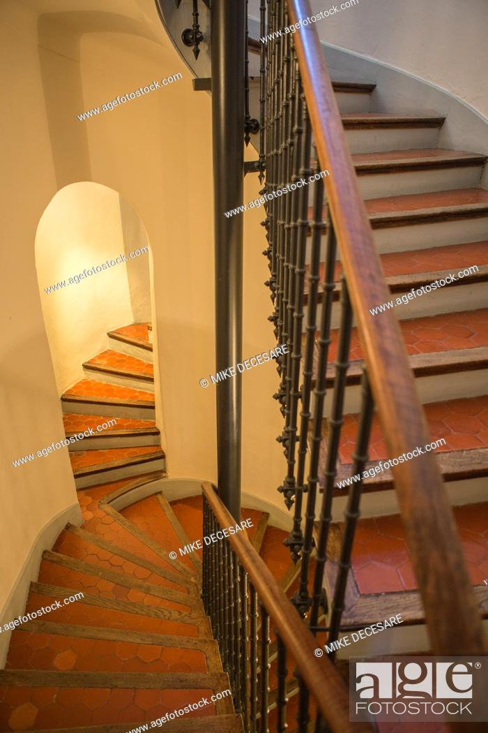 Stock Photo: A winding staircase in the Hotel la Bellaudere in Grasse, France, lead guests to their rooms and past the entrance to what was once the living quarters of.