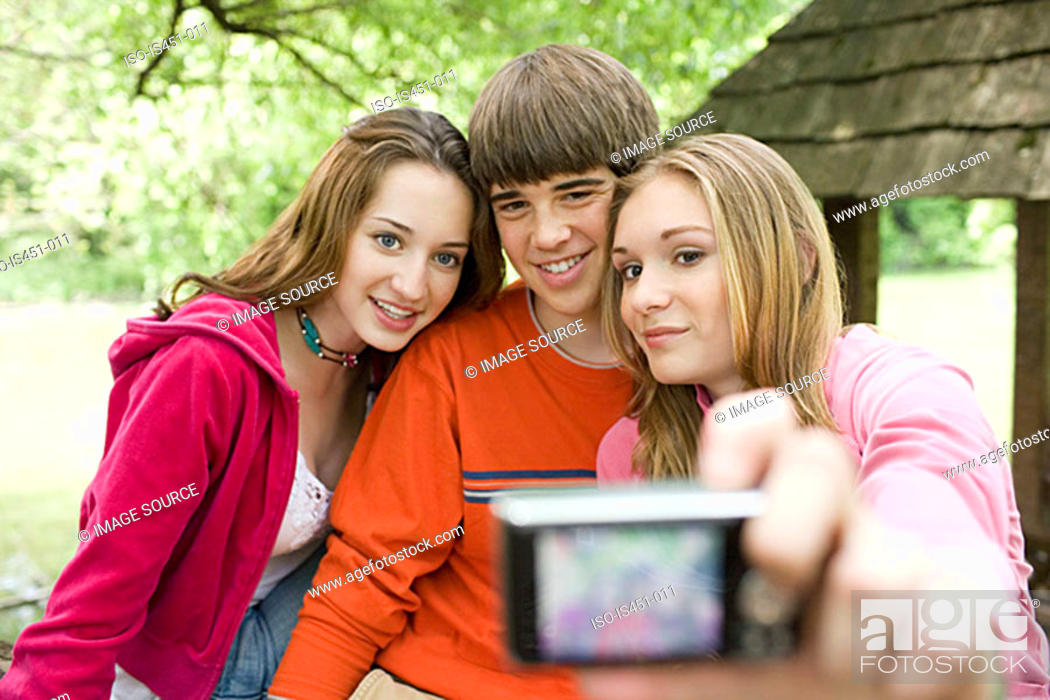 Stock Photo: Teenagers posing for photographs.