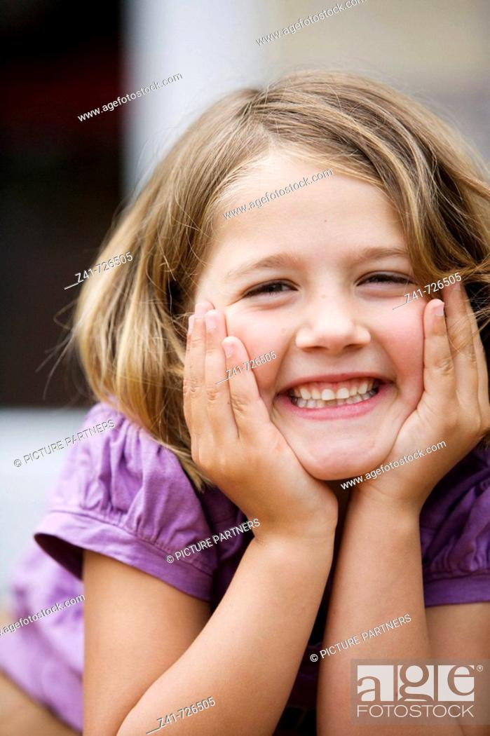 Stock Photo: Portrait of a happy little girl.