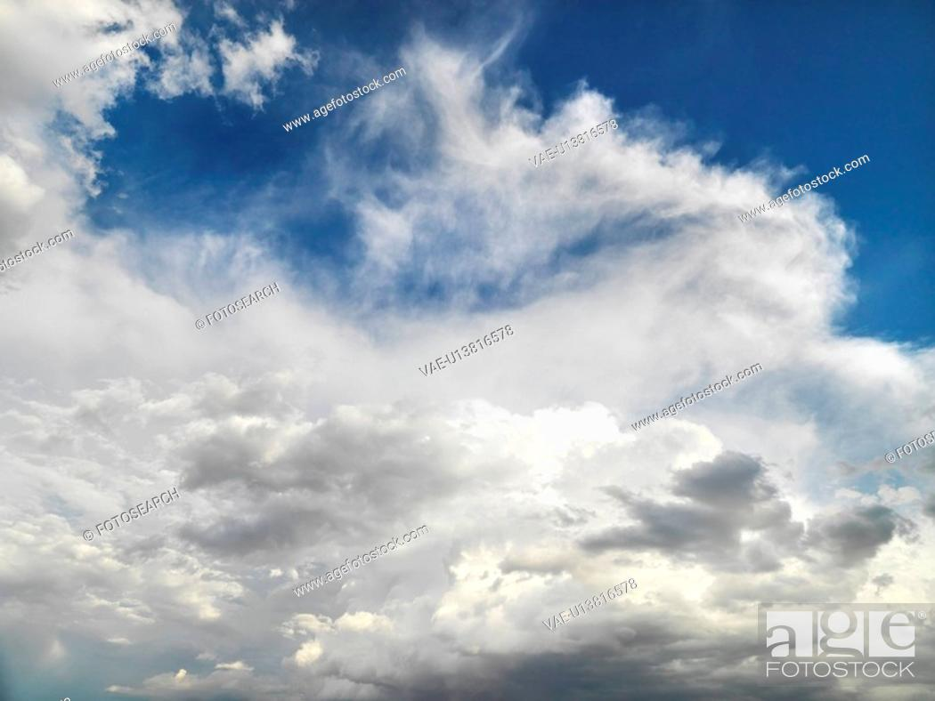 Stock Photo: White clouds in blue sky.