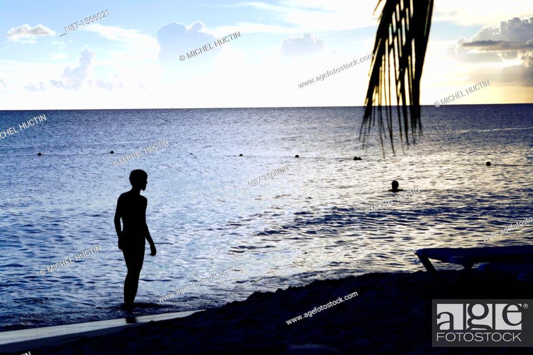 Stock Photo: Santo Domingo sunset on the beach.