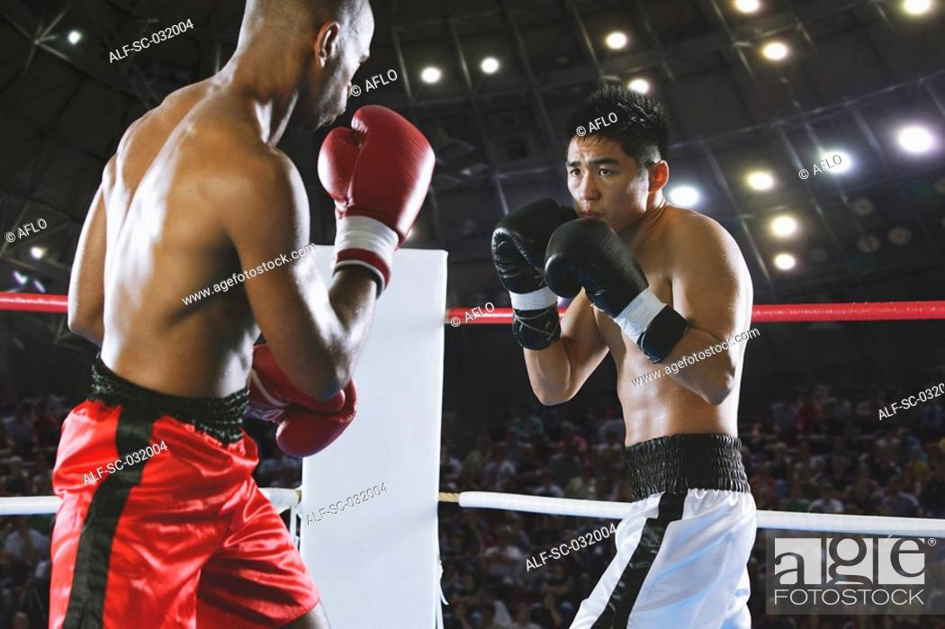 Stock Photo: Two boxers fighting in Boxing ring.