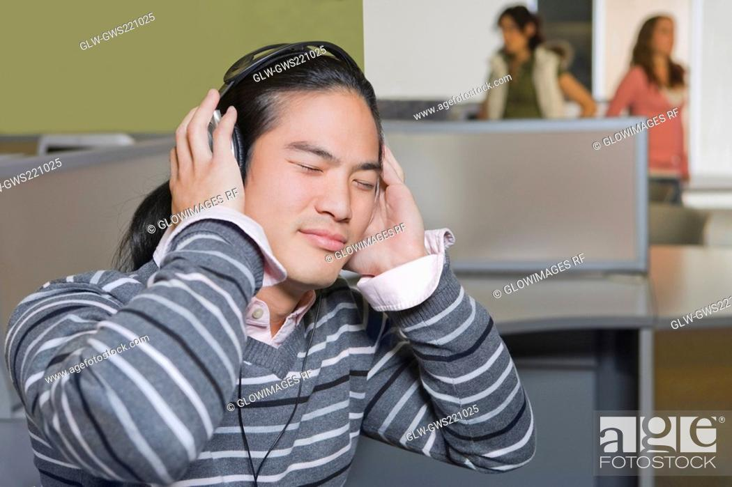 Stock Photo: Close-up of a young man listening to music with his eyes closed.