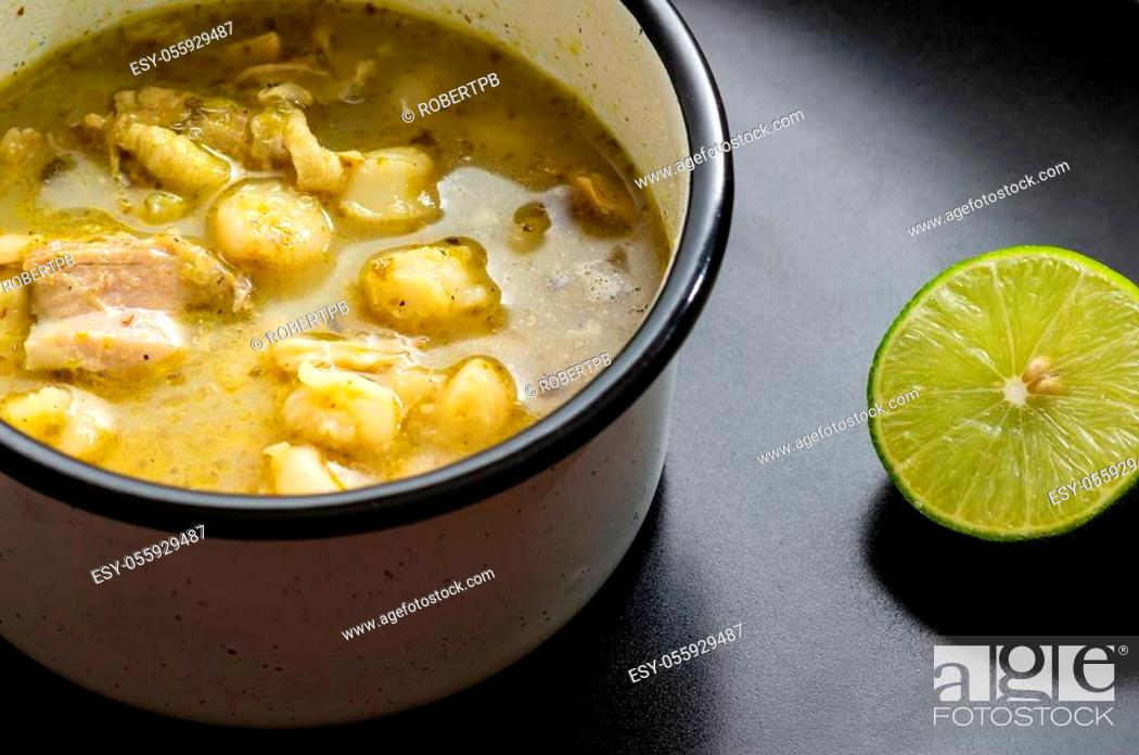Stock Photo: Pozole verde, or green posole is traditionally made with hominy and meat and topped with condiments. Mexican cuisine.