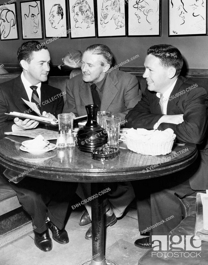 Stock Photo: Radio script writers, Jerry Lawrence (left), and Bob Lee (right), with James Hilton (center). May 27, 1952. They were collaborating on a script based on the.