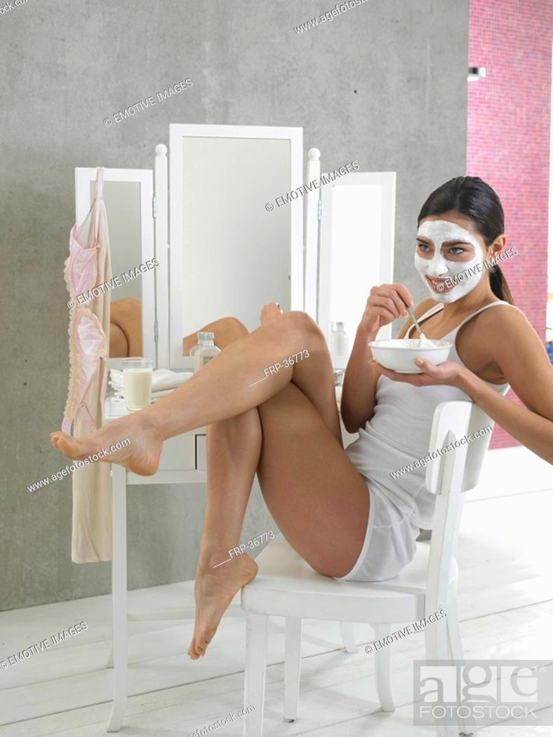 Stock Photo: Woman in white underwear with curd mask.
