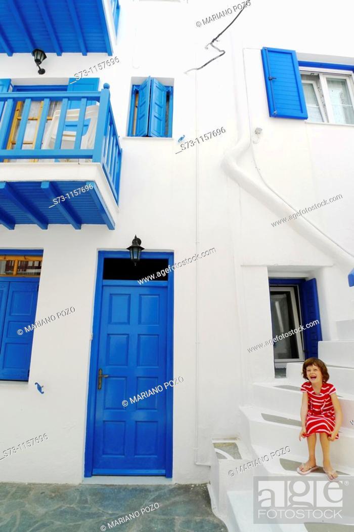 Stock Photo: Girl in a Mykonos house, Mykonos, Cyclades, Greece, Europe.