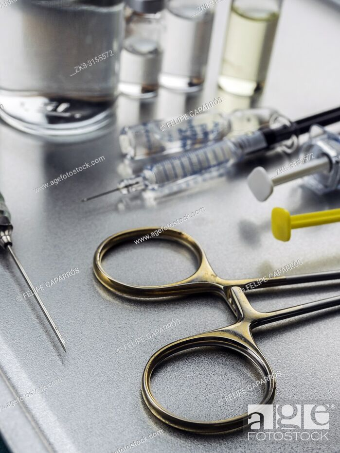 Stock Photo: Surgical scissors along with several roads to be injected into a hospital.