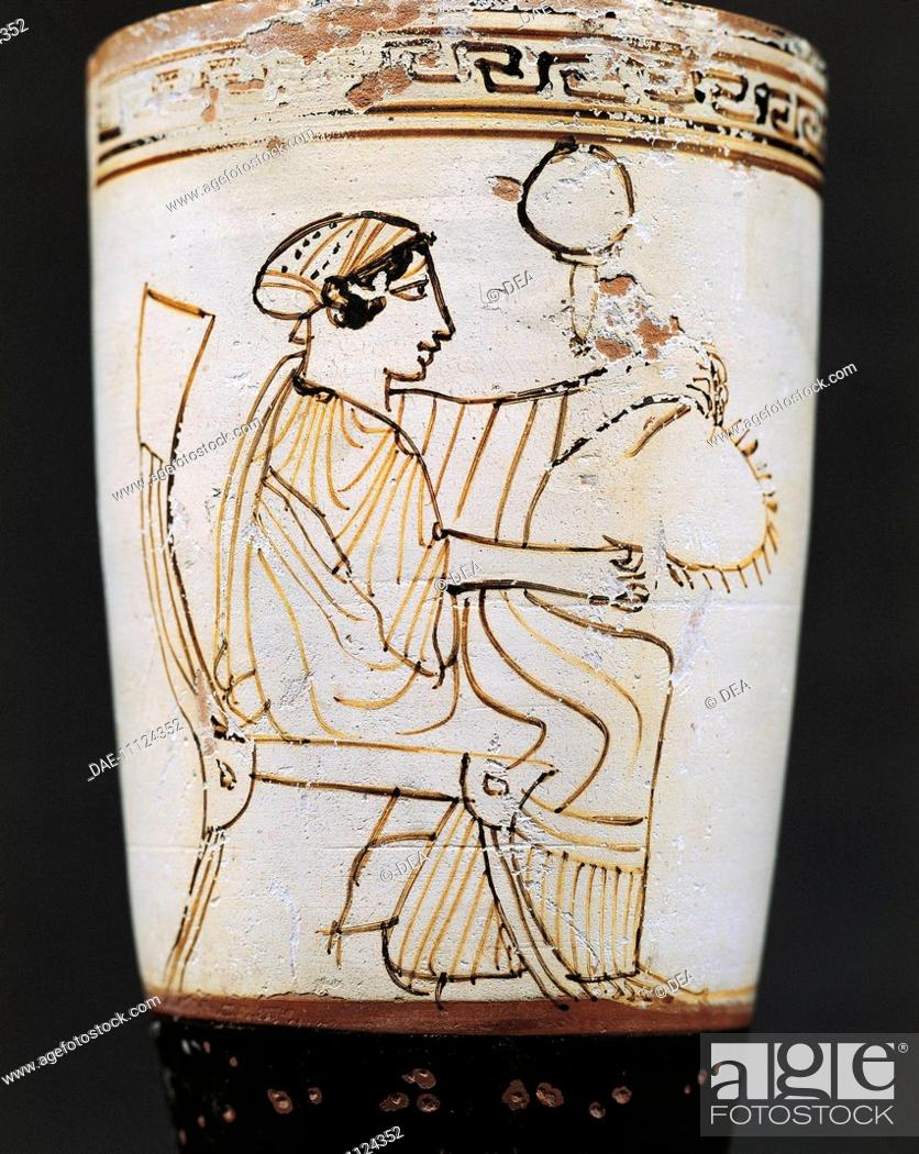 Stock Photo: Greek civilization, 5th century b.C. White ground pottery. Lekythos, oil flask attributed to Tymbos Painter depicting a woman weaving a crown.