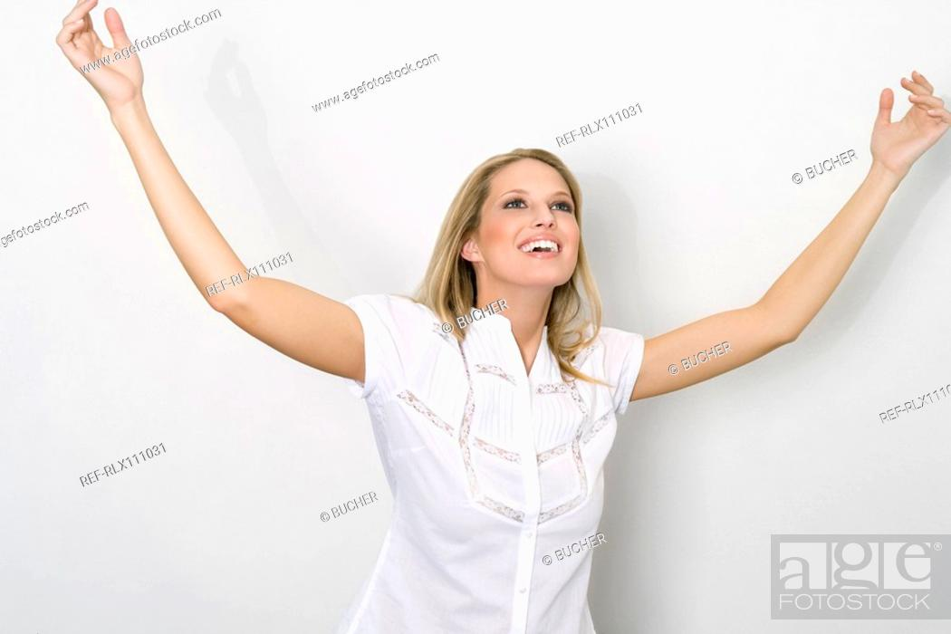 Stock Photo: Young woman raising hands.