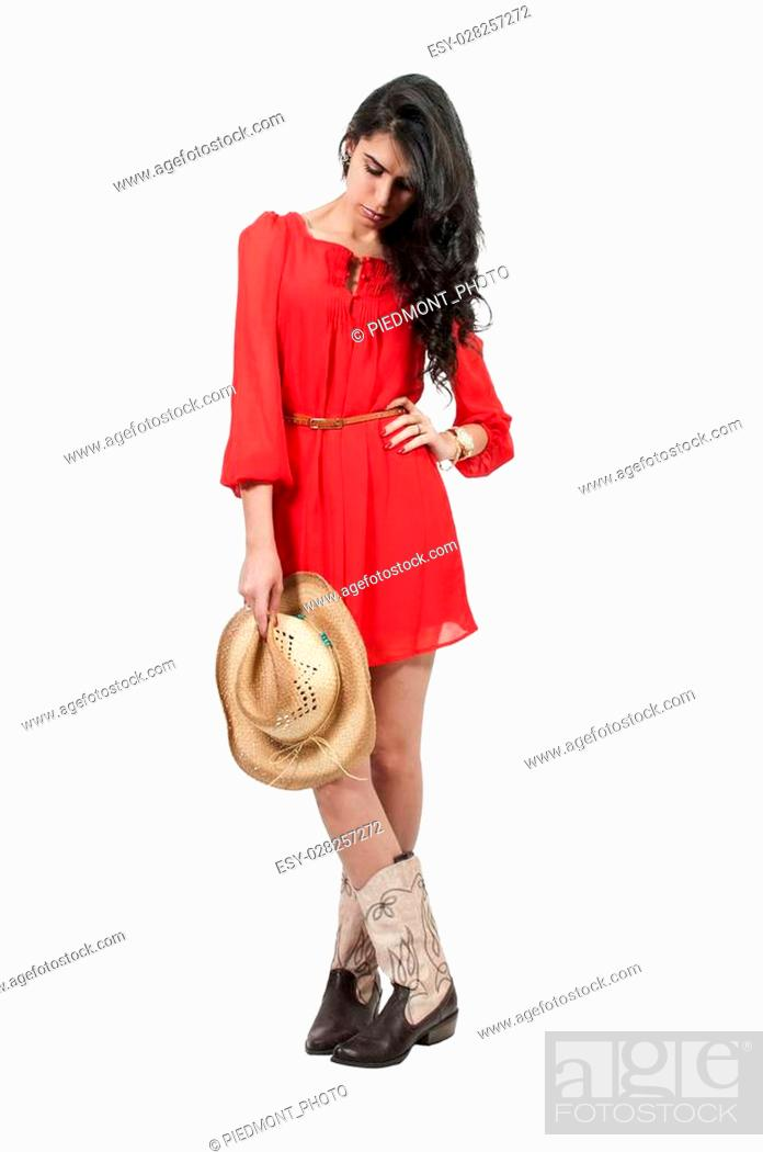bd93a7905a5 Beautiful young country girl woman wearing a stylish cowboy hat ...