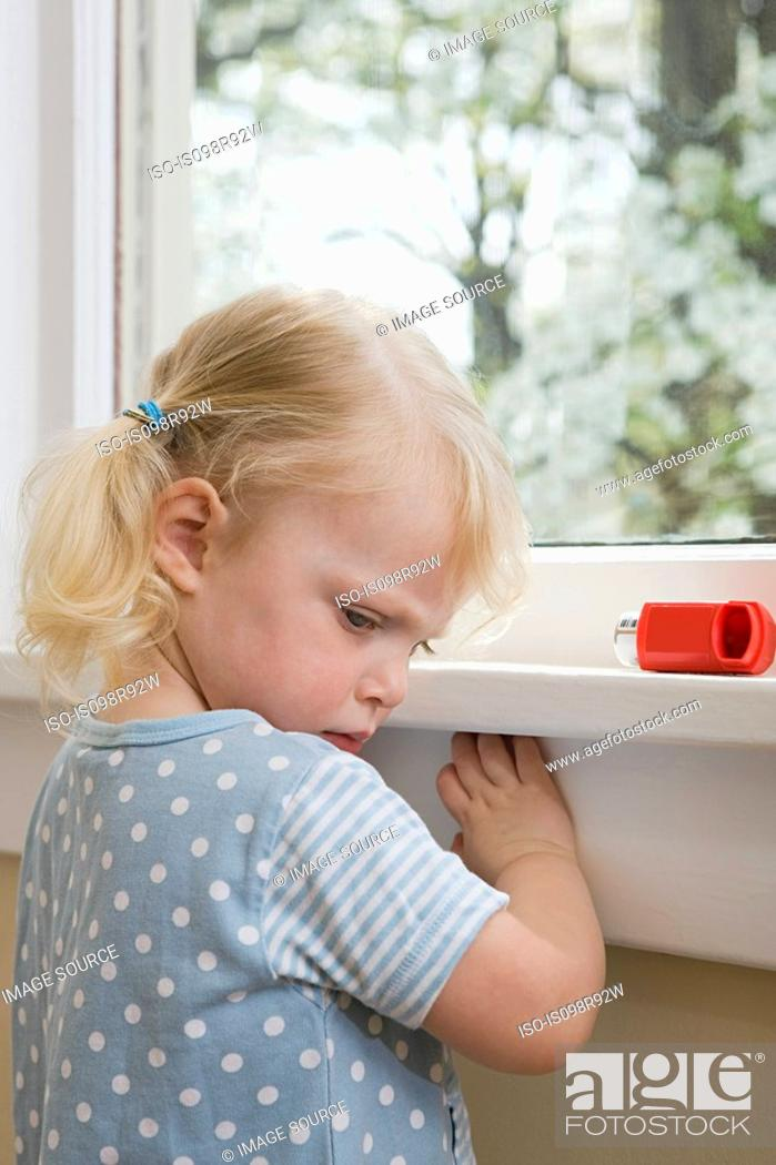Stock Photo: Girl with asthma inhaler.