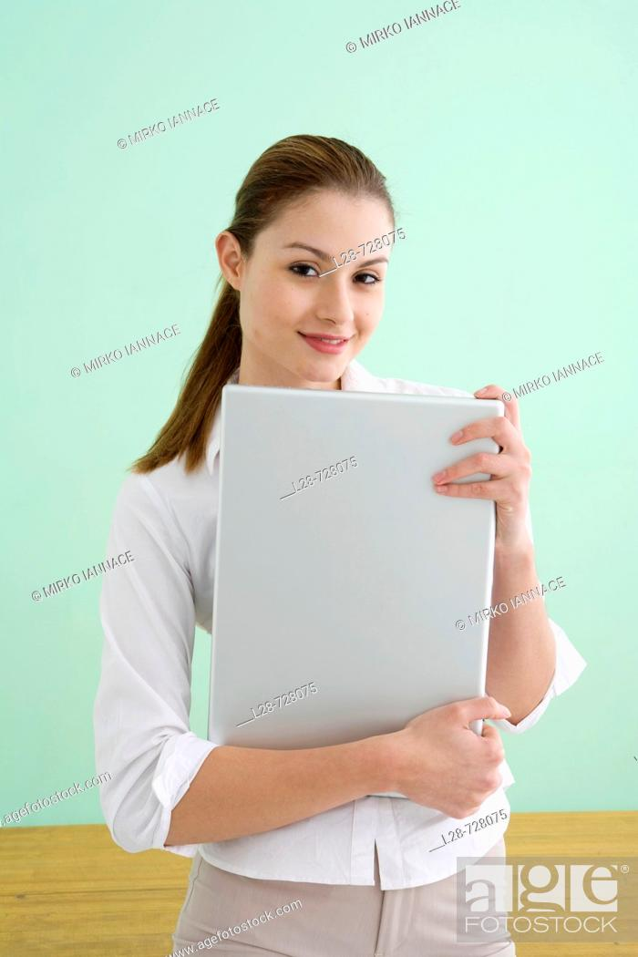 Stock Photo: Businesswoman holding laptop, smiling, portrait.