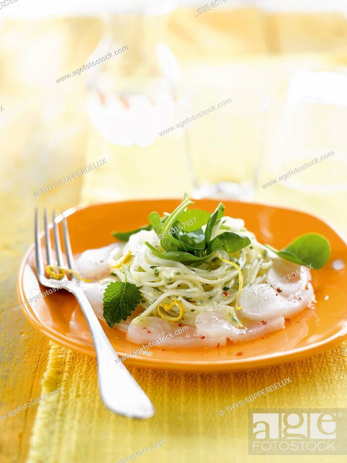 Stock Photo: Thinly sliced fish and spaghettis with spinach and lemon.