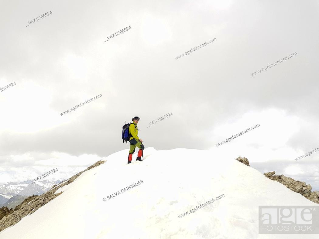 Stock Photo: Mountaineer ascending to the peak of Vallibierna, Huesca, Aragon, Spain.