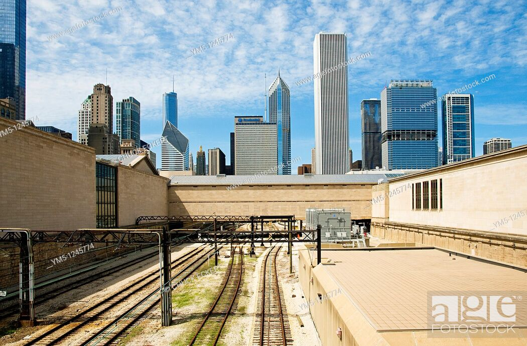 Stock Photo: AmTrack Railroad tracks running under the Art Institute of Chicago with the skyline looming in the background.