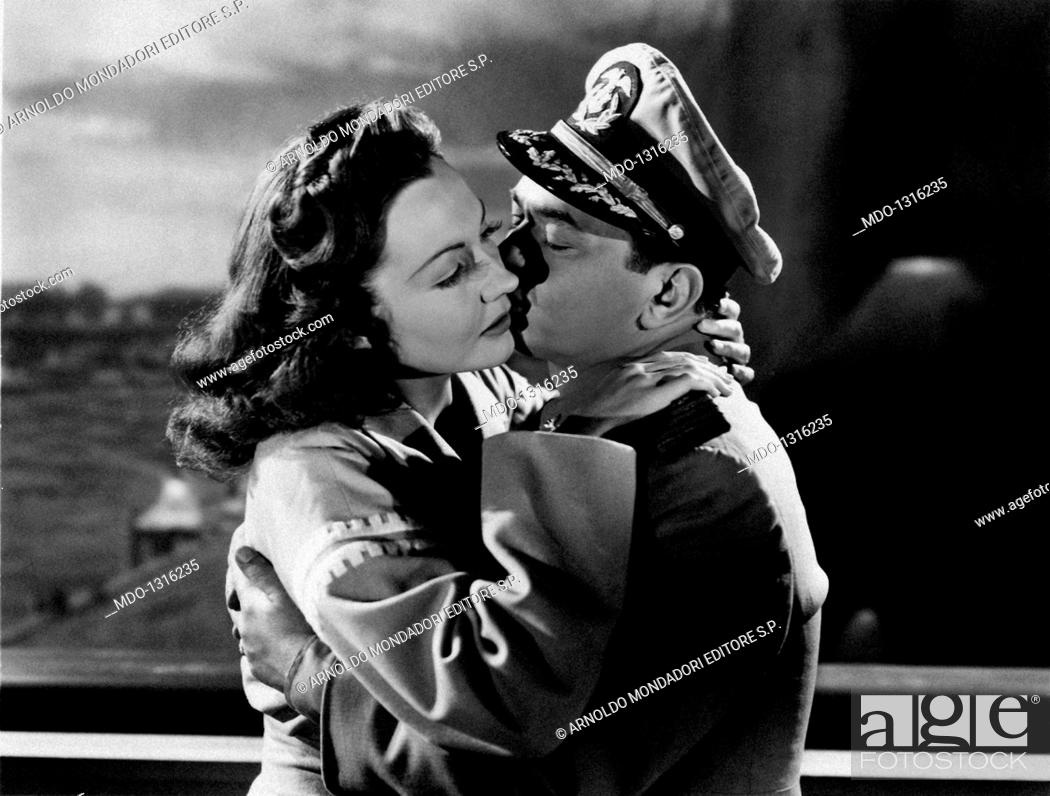 75c93e0025d Stock Photo - Edward G. Robinson and Lynn Bari kiss in a movie scene.  Edward G ... . Robinson and Lynn Bari