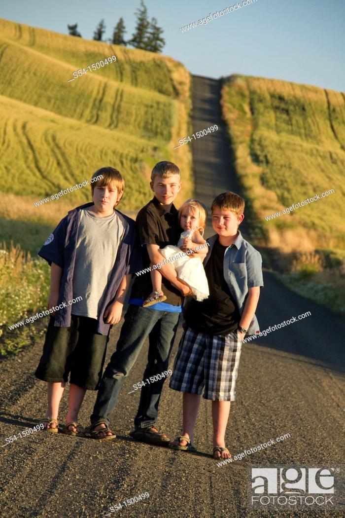 Stock Photo: Three boys and their toddler sister on a road near Fairfield, Washington, in the Palouse.