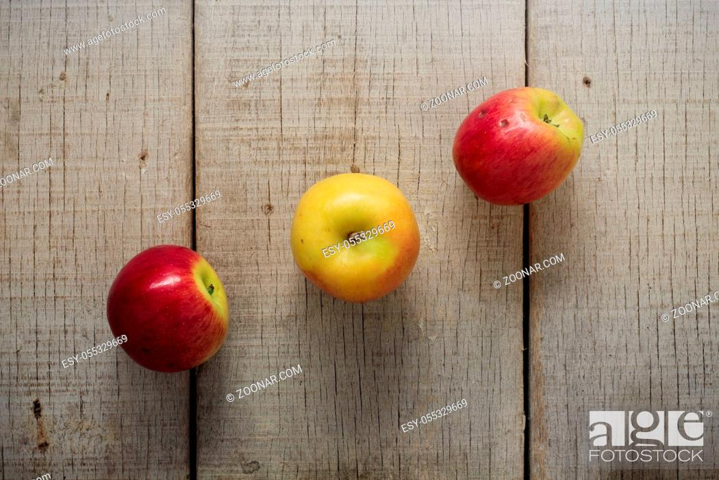 Stock Photo: Apple lined up on the old wooden floor.