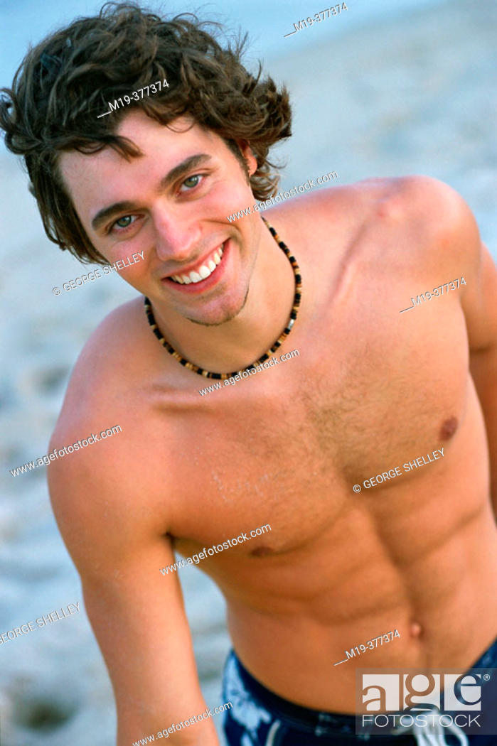 Stock Photo: young man in a bathing suit.
